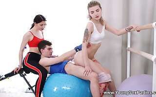 Erotic FFM threesome with Monroe Fox and Rin White in the gym