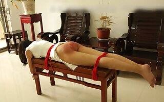 Traditional paddling in Asia - Fetish bondage