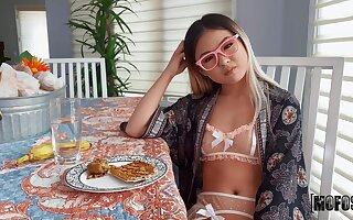 Bespectacled Asian teenager Lulu Chu puts first of all a magic show