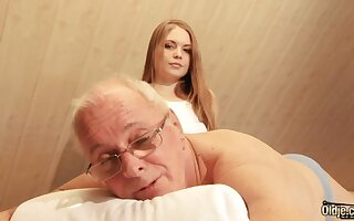 Seductive hot young masseuse is assuredly busy just about riding cock of old pervert