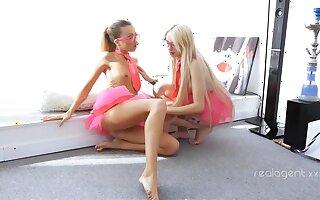 Hot lesbian in pink uniforms having respect