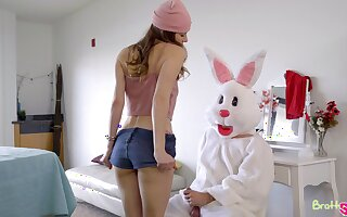 A baffle dressed in an Easter bunny costume fucks two bad girls